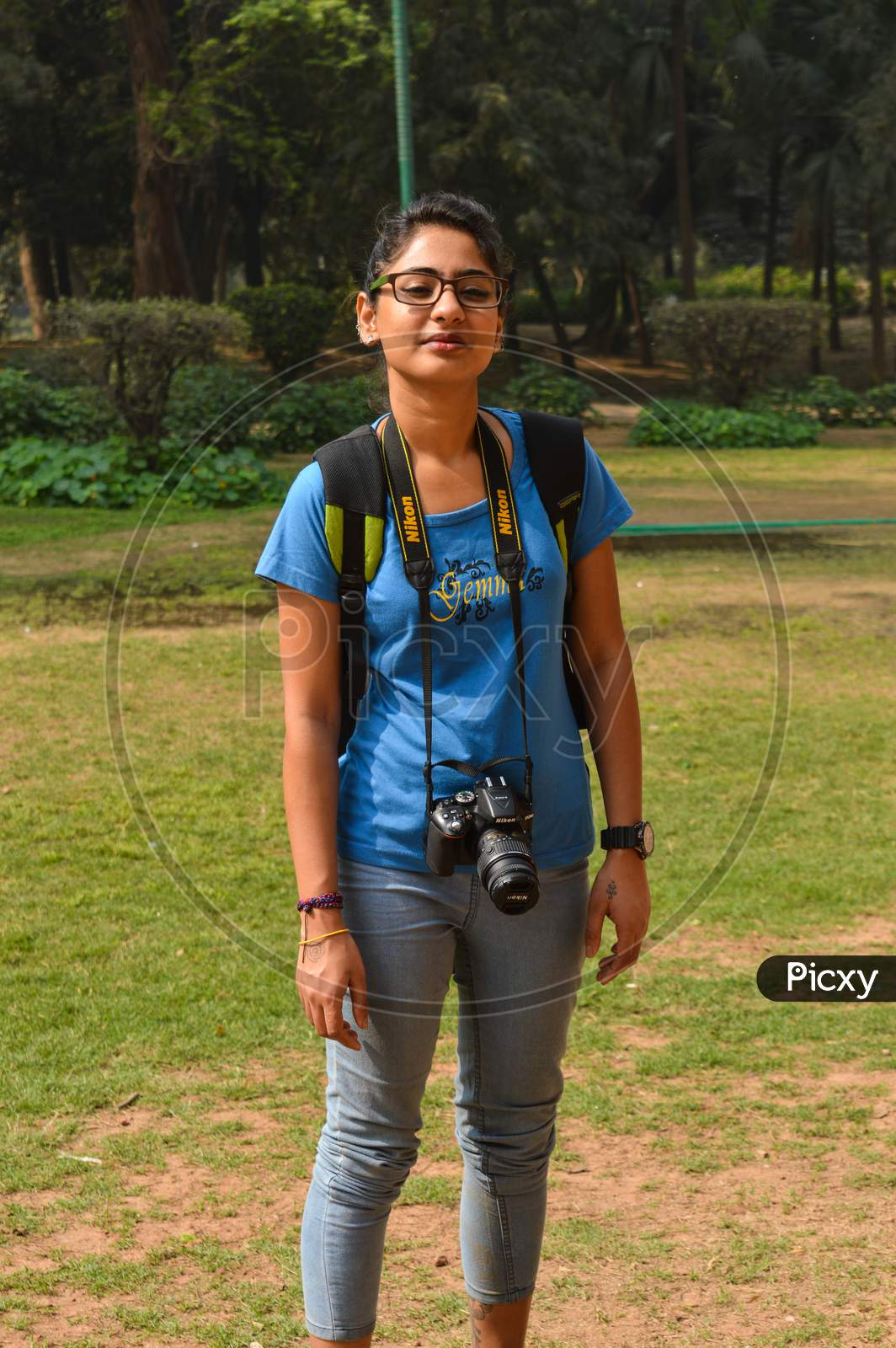 A Portrait Of Student Of Photography At Lodhi Garden Park With Nikon Camera.
