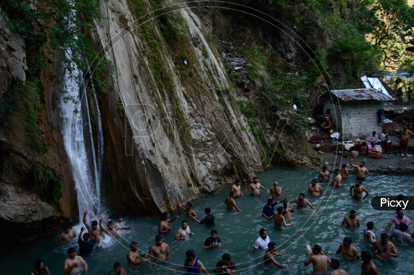 Group Of People Enjoying Under The Famous Neer Garh Waterfall, Rishikesh, Uttarakhand India.