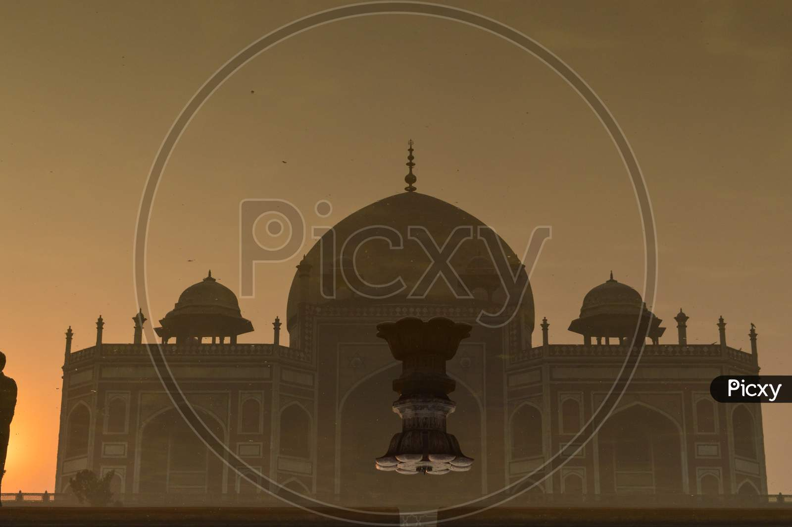 A Reflection In Water And Mesmerizing View Of Humayun Tomb Memorial From The Main Gate,Entrance At Winter Foggy Morning.