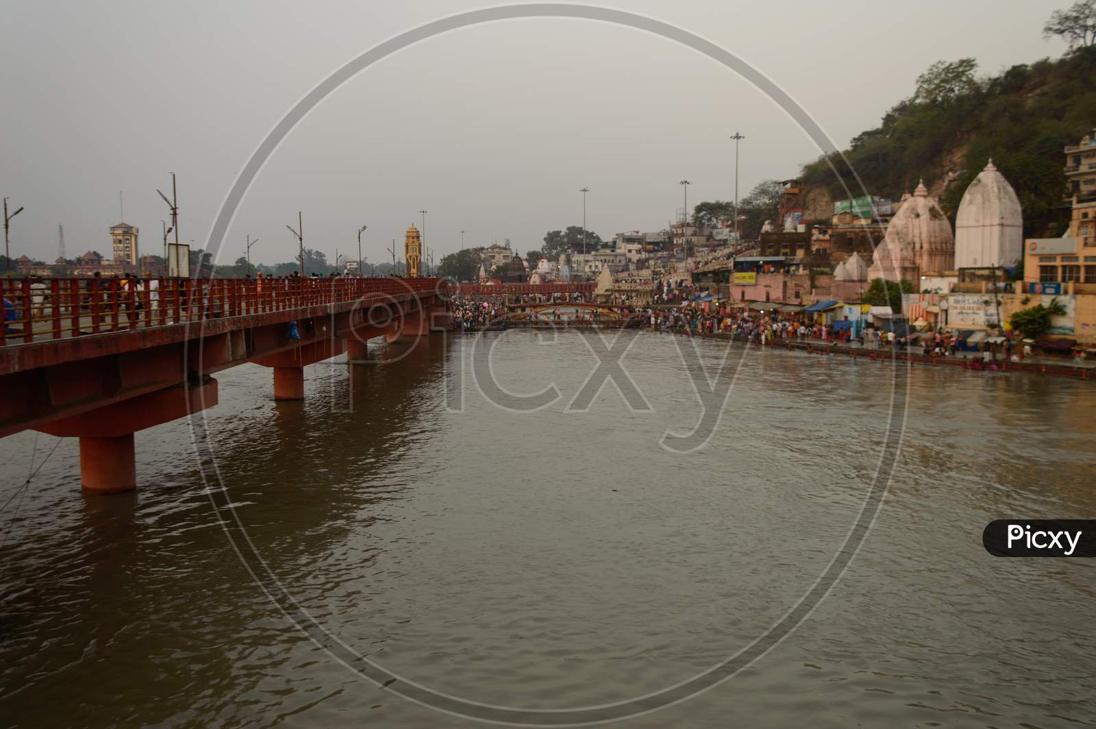 A Landscape View Of Bridge At Ganga River In Haridwar Public Going To Take Bath In Ganga River Temple Sky.