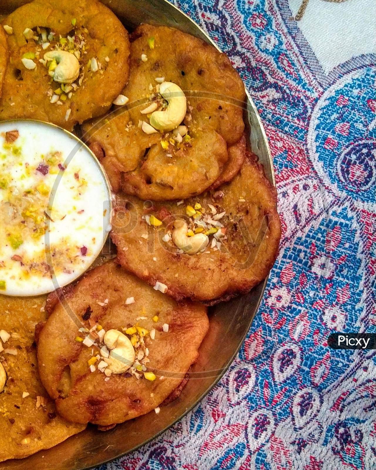 indian style malpua filled with goodness of dry fruits and banana