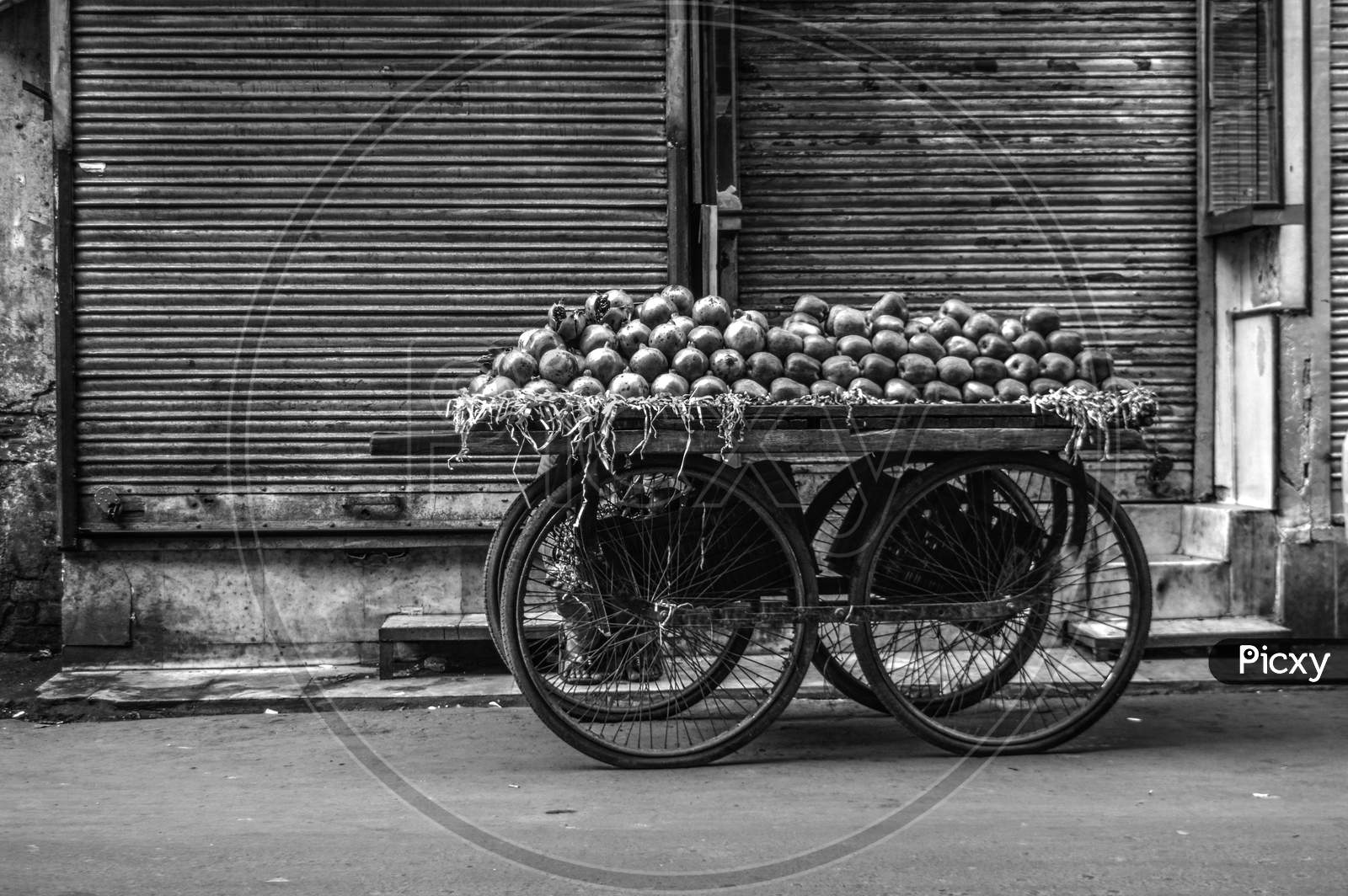 A Pomegranate Cart Is Waiting For Customer At Street Of Chandni Chowk