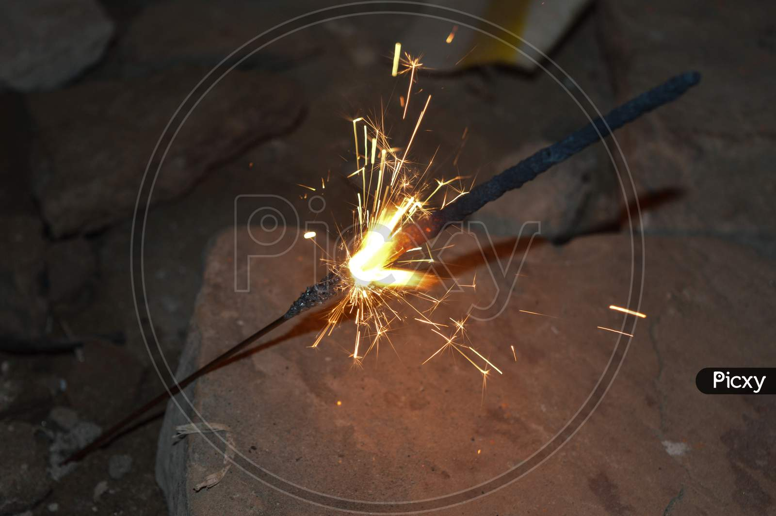 Indian Lady Playing With Fire Cracker Rose And Candle On Indian Festival Diwali Deepawali With Fire Isolated On Table