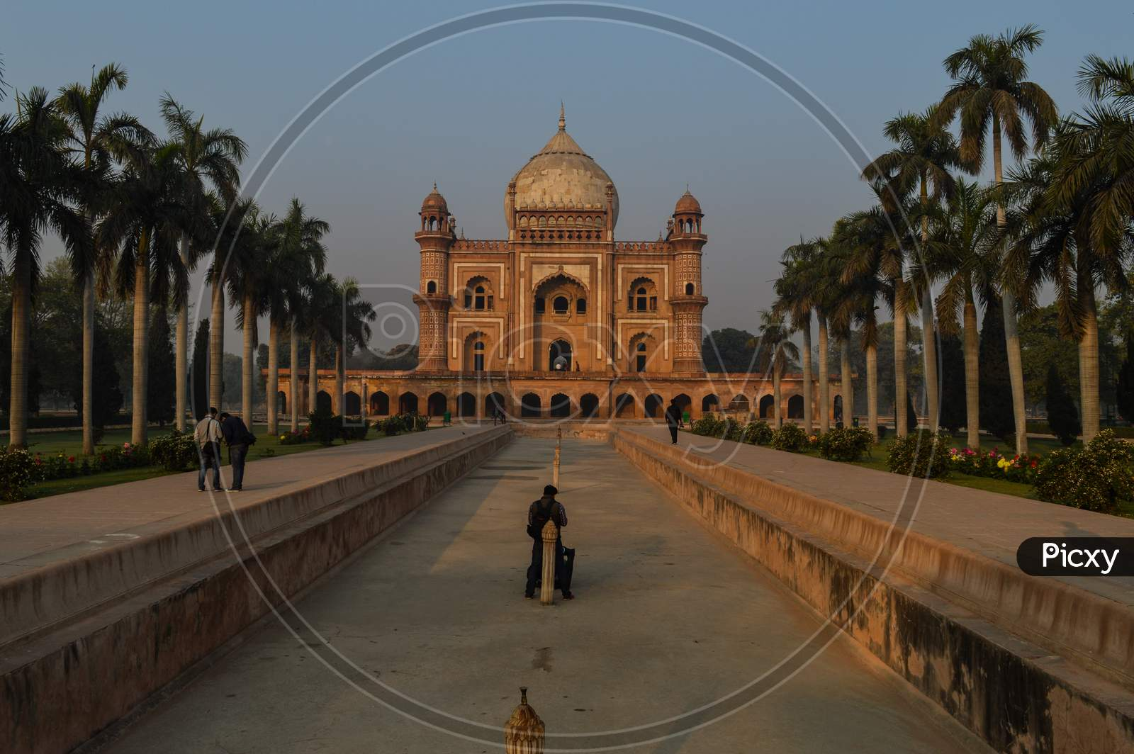 A Bunch Of Photography Students Standing And Taking Picture In-Front Of Safdarjung Tomb Memorial At Winter Morning.