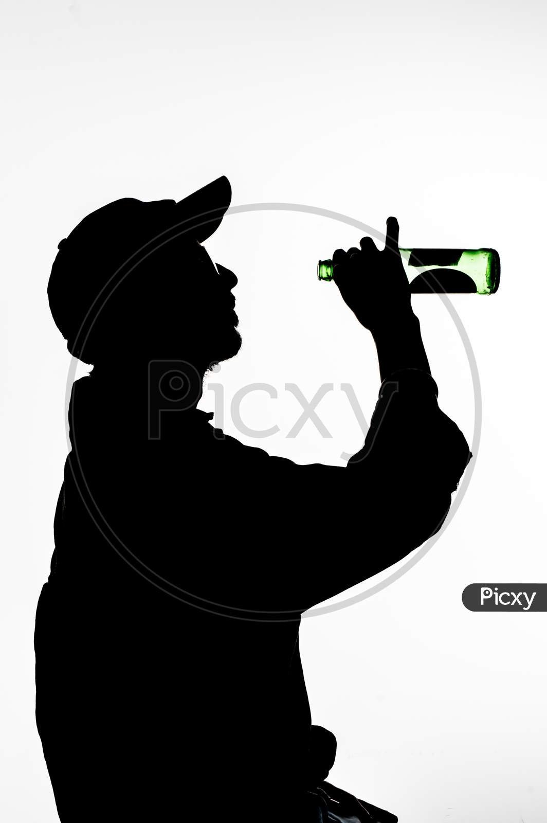 A Silhouette Of Men Who Is Drinking Beer
