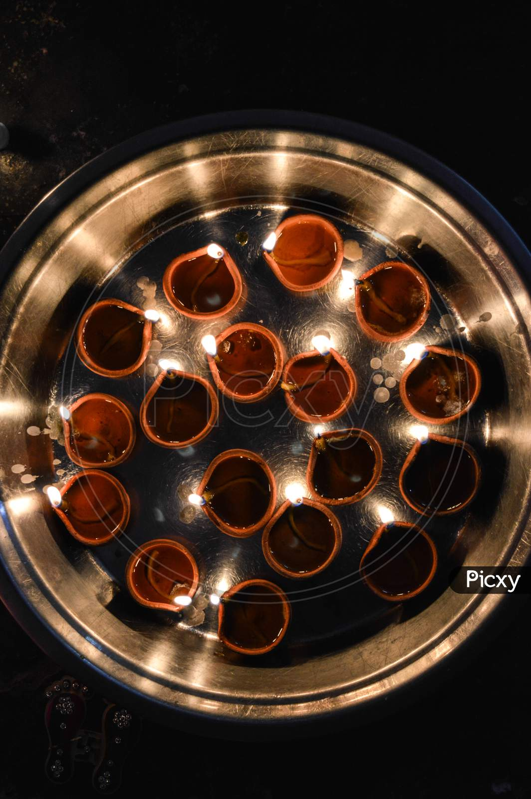 A Plate Is Which Is Loaded With Rose And Candle On Indian Festival Diwali Deepawali With Fire Isolated On Table