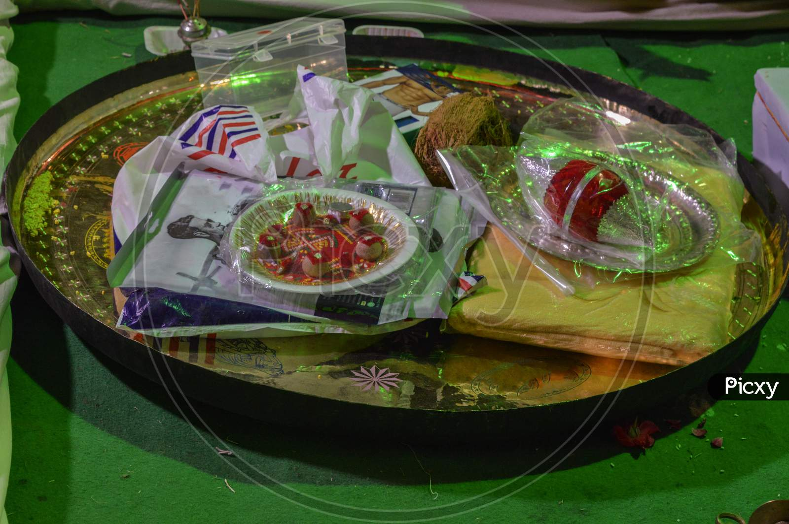 A Plate Which Is Loaded With Betel Nut, Silver, Coconut, In One Of The Ritual Called Tilak Ceremony In Indian Marriage.