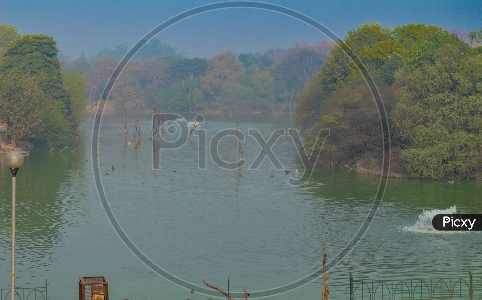 A Mesmerizing View Of Hauz Khas Lake And Garden From The Hauz Khas Fort At Hauz Khas Village At Winter Foggy Morning.