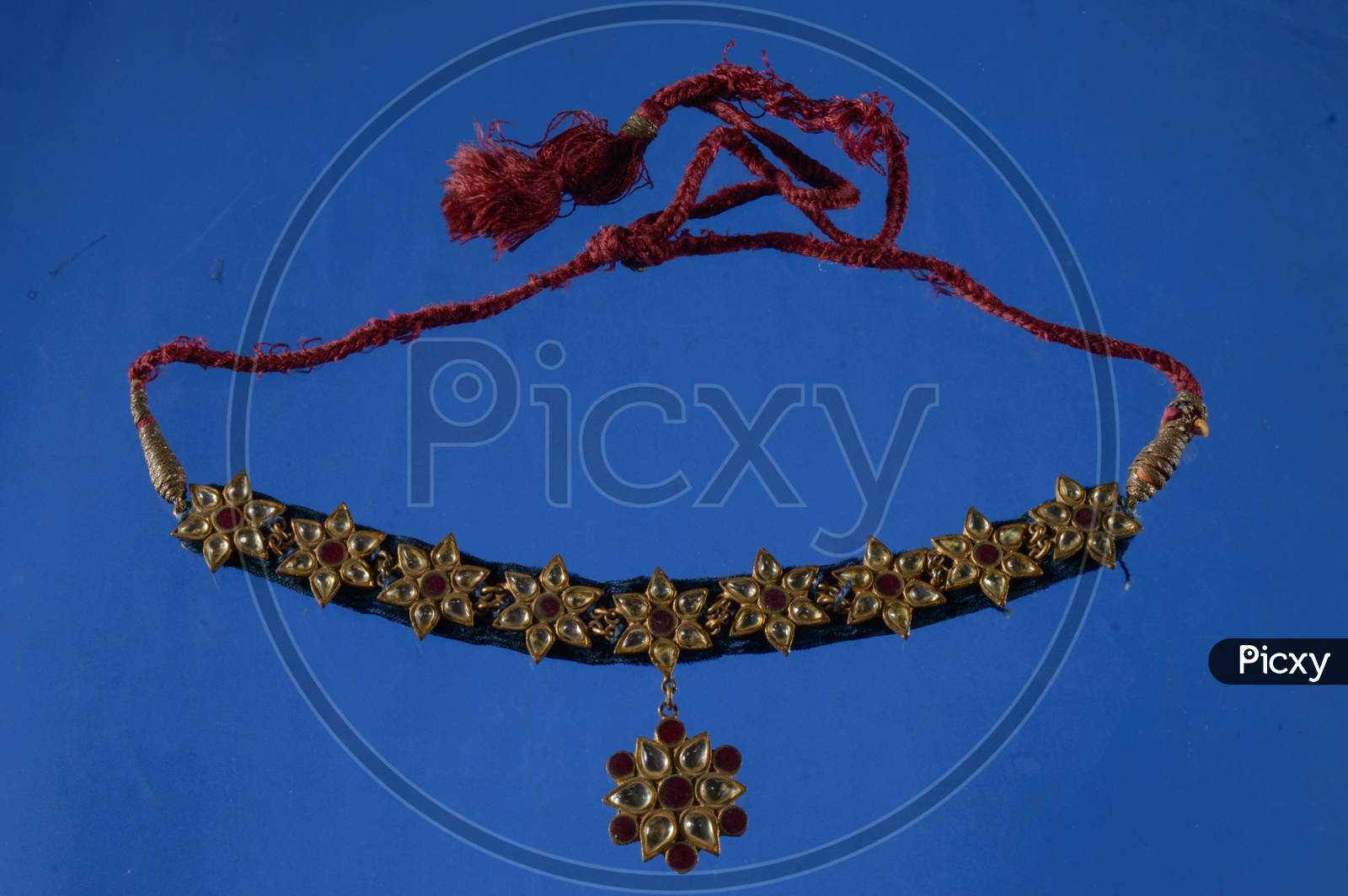 Beautiful Antique Indian Necklace Isolated On Blue Background With Diamond And Stone