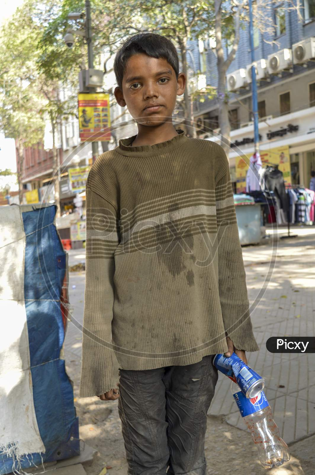 A Indian Child Beggar Asking For Money For Buying Food.