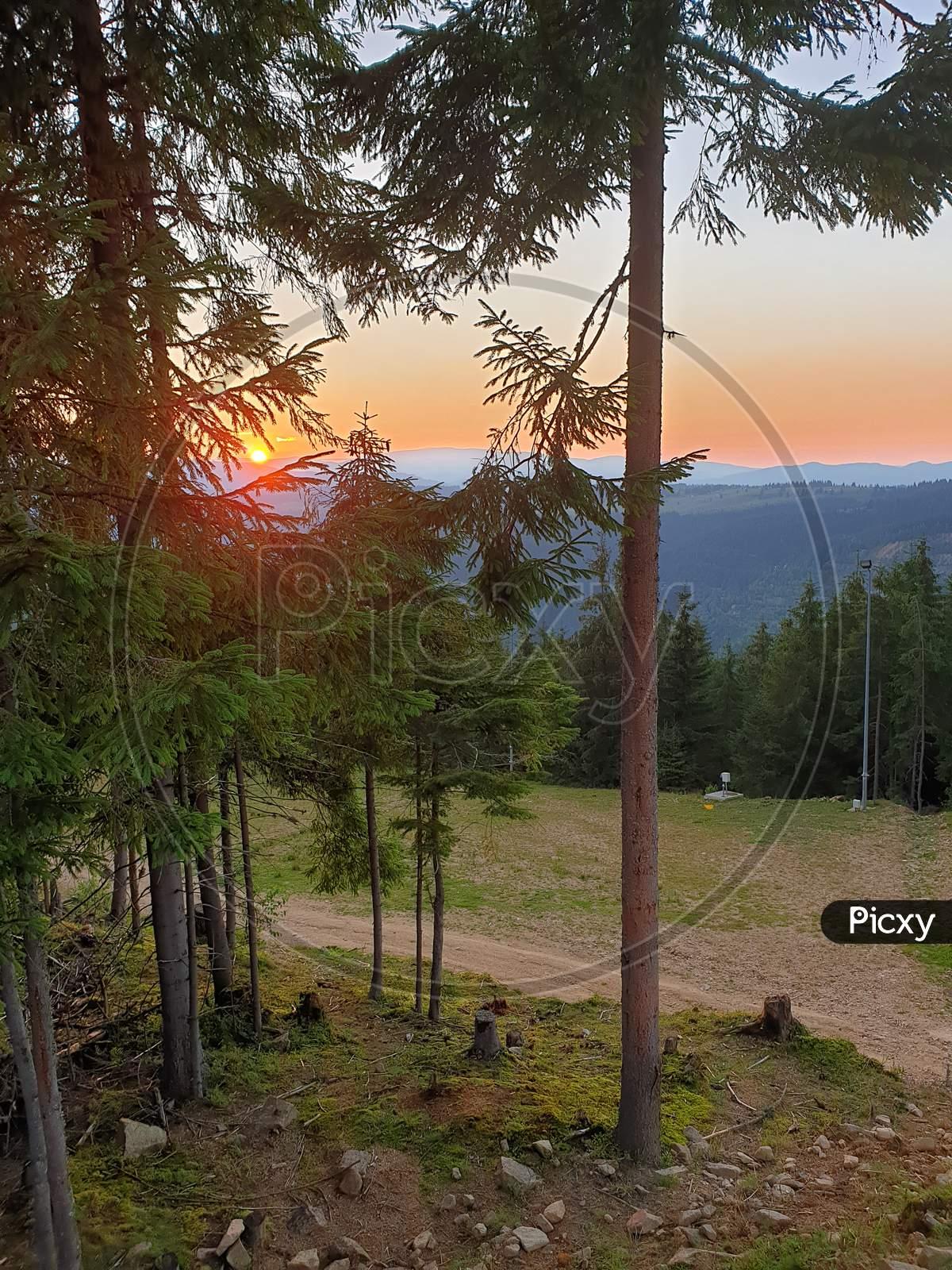 Marisel Ski Slope In Summer At Sunset, Romania