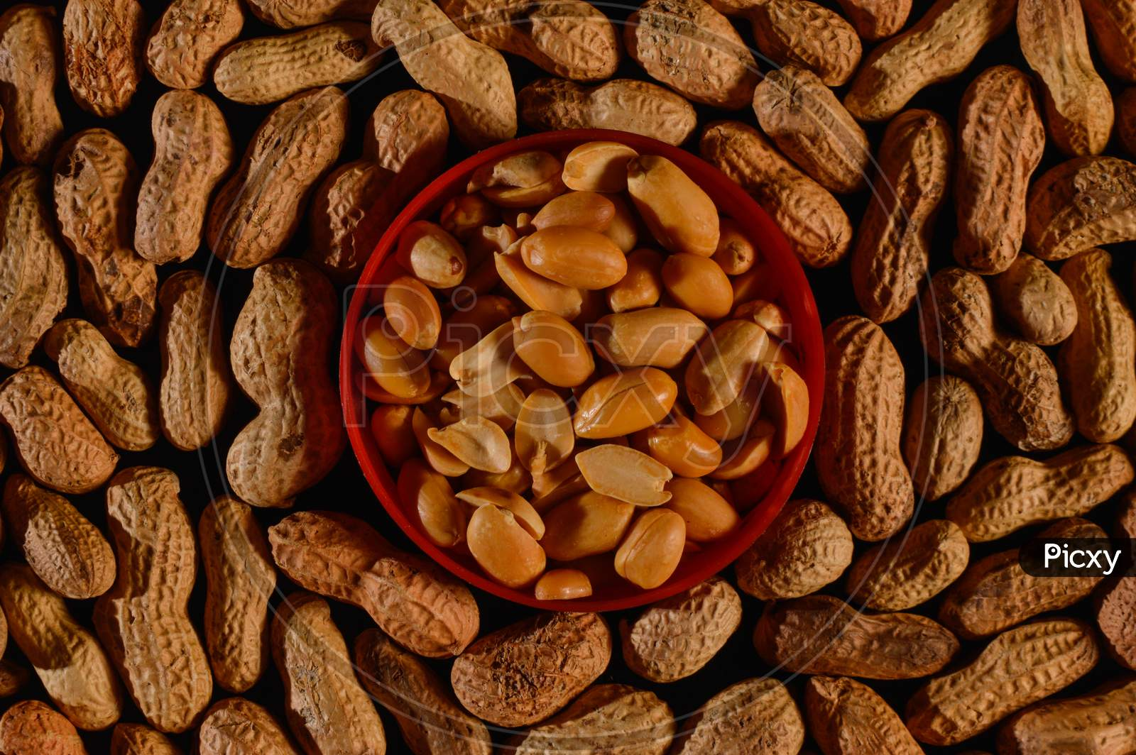 Peanut In A Shell Texture,Background Of Peanuts With A Plastic Plate