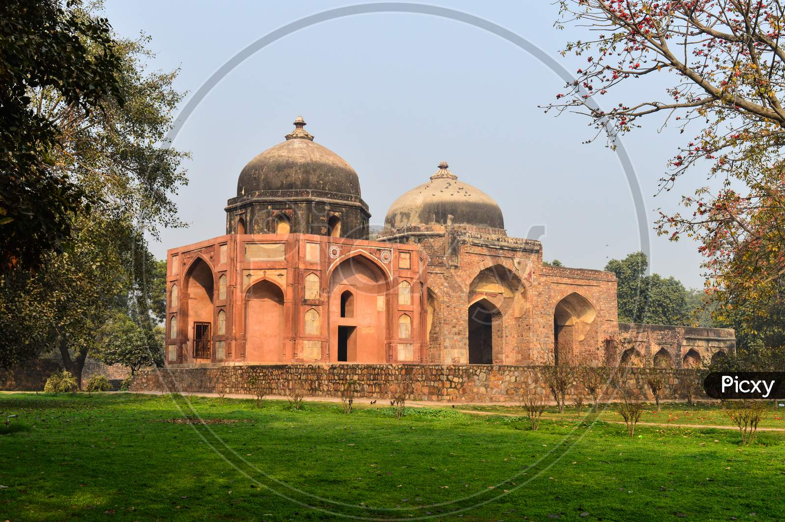 A Monument At Humayun Tomb Memorial From The Side Of The Lawn At Winter Foggy Morning.