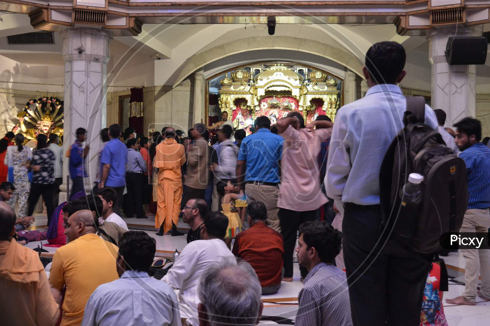 People Are Looking At God Lord Krishna And Praying For Good Wealth And Health On The Indian Festival Of Lord Krishna Birth Ceremony( Janmastami) At Iskcon Temple New Delhi, India.