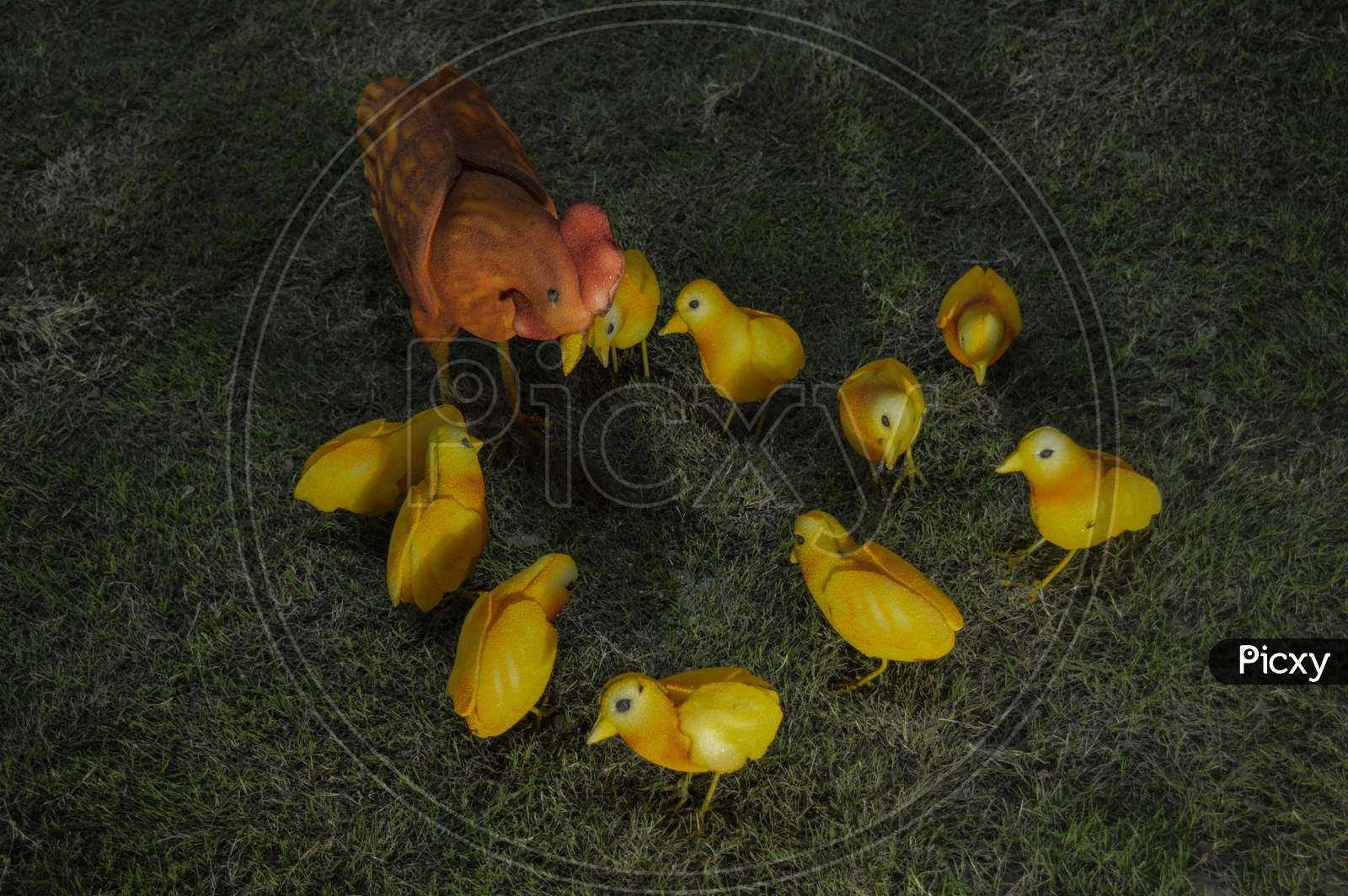 Hen Family Finding Insect Statue.