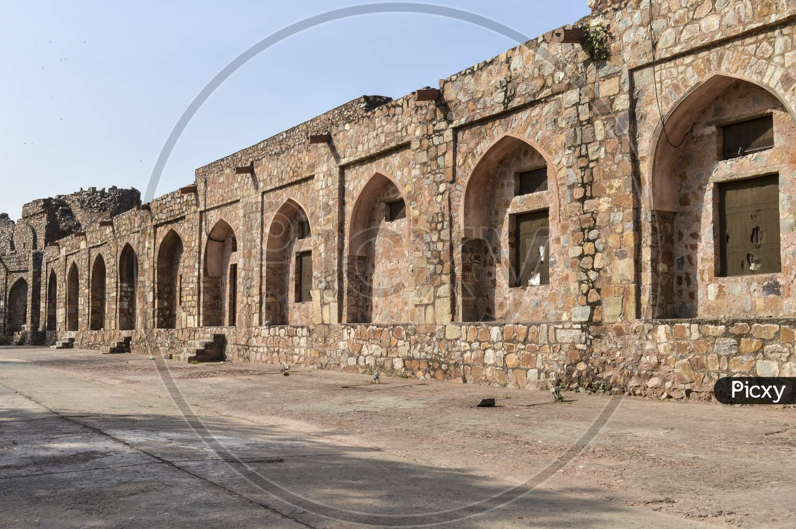 A Mesmerizing View Of Architecture Of Small Tomb At Old Fort From Side Lawn.