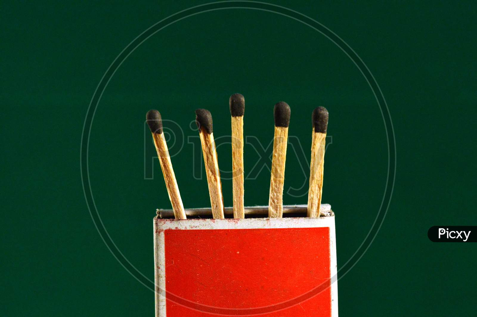 Wooden Matchsticks With Box Stand With Green Background