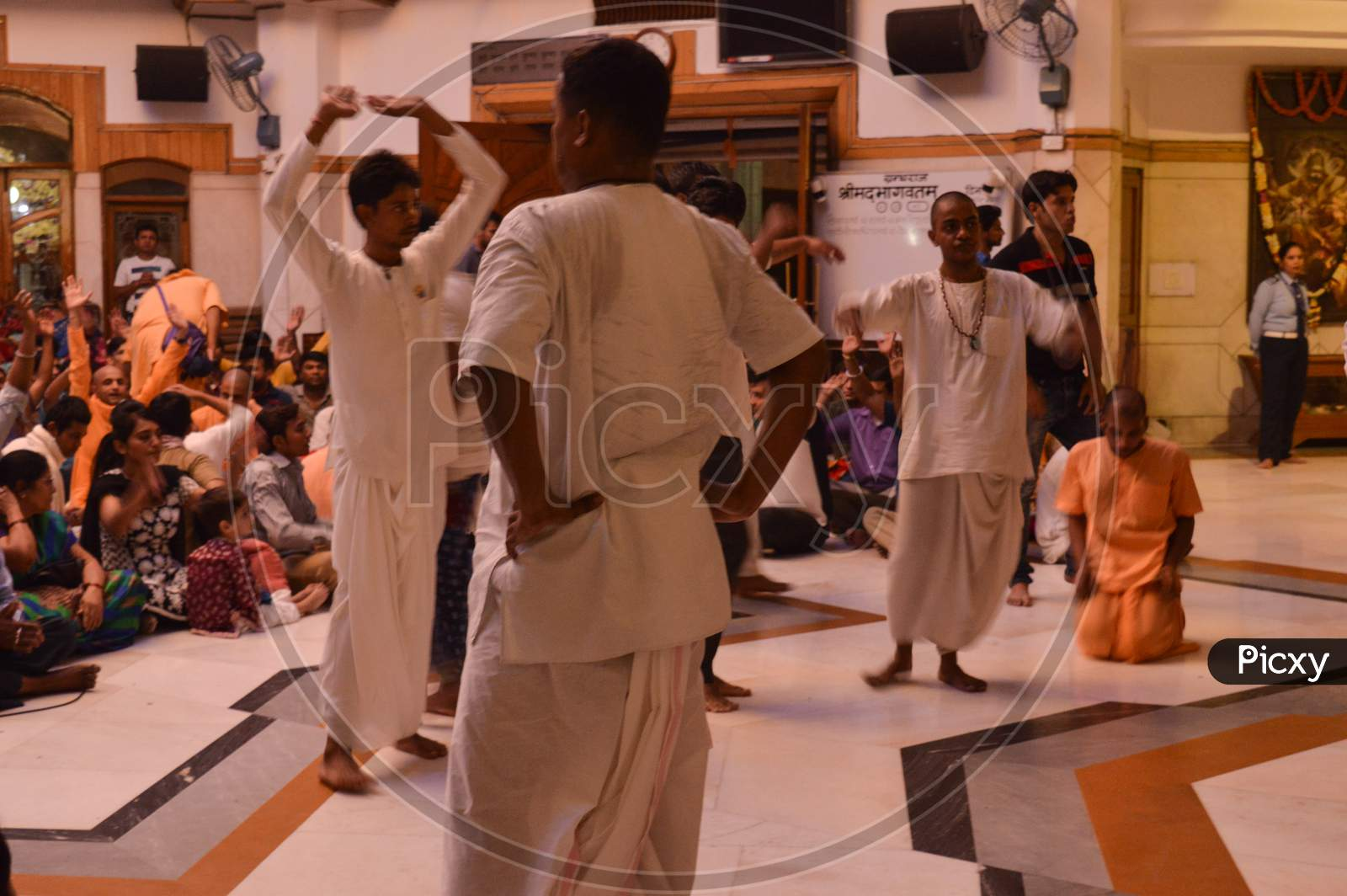 On The Indian Festival Of Lord Krishna Birth Ceremony( Janmastami) People Are Dancing, Enjoying, Celebrating, Raising Hand At Night At Iskcon Temple New Delhi, India.