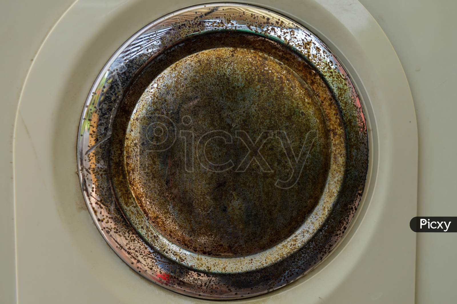 A Rustic Piece Of Steel Isolated On White Plastic.