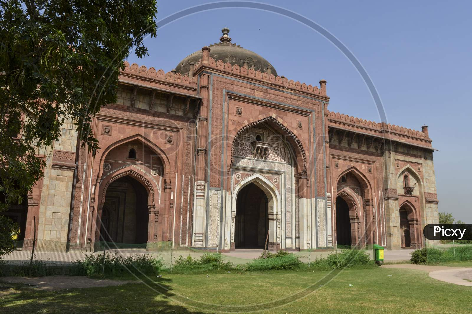 A Mesmerizing View Of Architecture Of Main Tomb At Old Fort From Side Lawn.