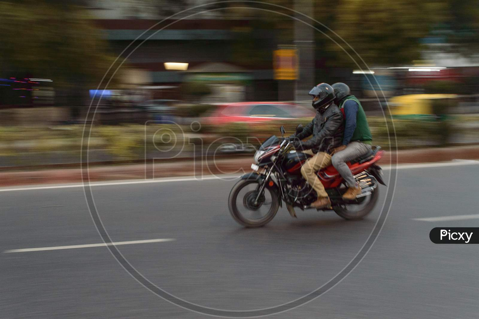 Panning Technique Of Red And Black Bike Going Somewhere At Evening On The Road
