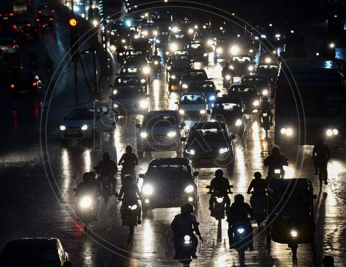 Vehicles move on road as it rains heavily in Hyderabad on September 16,2020