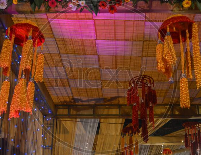 A Beautiful Hanger Decoration In Indian Wedding With Fairy Lights.
