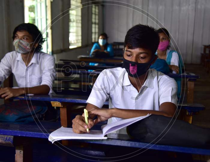 Students maintain social distancing as they attend a class after schools and colleges reopened after more than 5-months closure due to the Covid-19 coronavirus pandemic in  Nagaon District of Assam on Sep 21,2020.
