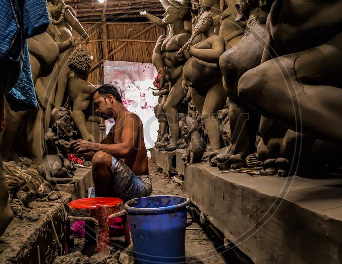 Craftsman is working to complete the Durga fetish for upcoming Durga puja During Amidst Coronavirus or COVID-19 Pandemic At Champahati In South 24 pgs District Of West bengal ,India on 20 Sep, 2020.