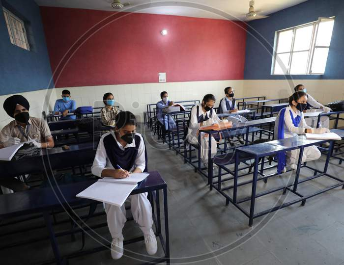 Students attend their school in Jammu on 21 September,2020. The schools across Jammu region partially reopened for 9th to 12th classes after six months closure due to the outbreak of Coronavirus pandemic.