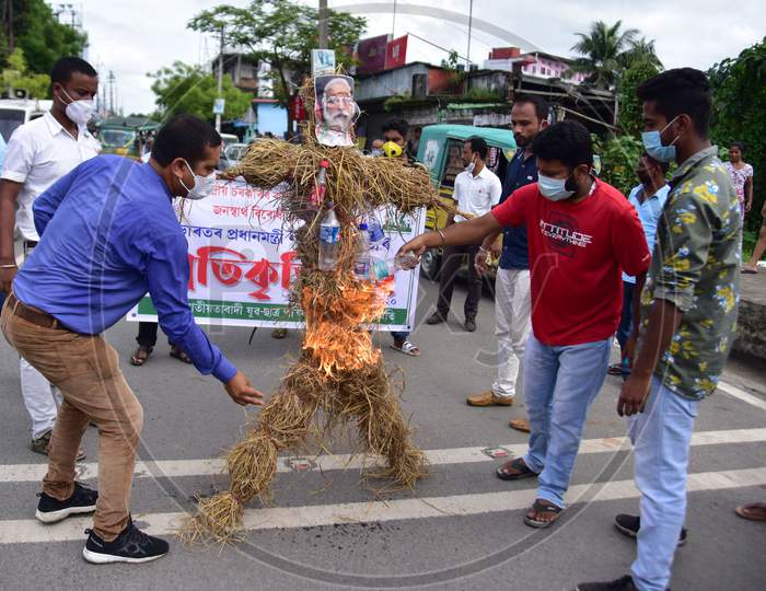 Asom Jatiyatabadi Yuba Chatra Parishad (AJYCP) activists burn effigies of Prime Minister Narendra Modi  during a  a protest against recent  farm bills  in Nagaon District of Assam on Sep 23,2020