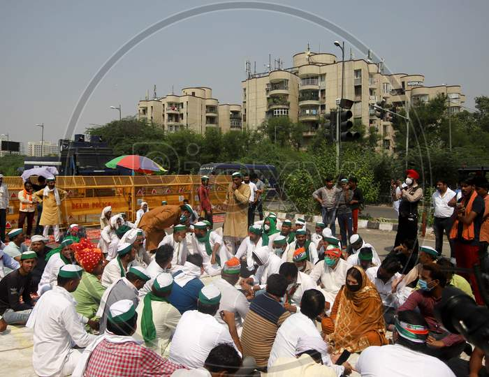 Farmers block the Delhi-Noida border road during a protest against farm bills passed by India's parliament, in New Delhi, India, September 25, 2020.