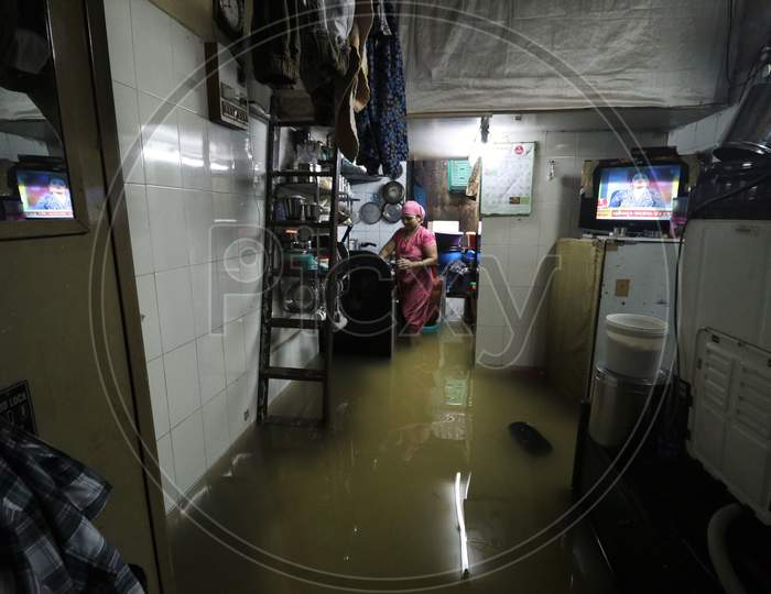 A woman is seen inside her house that is waterlogged due heavy rains, in Mumbai, India on September 23, 2020.