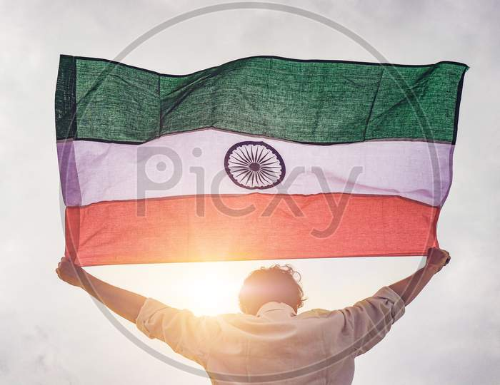 Indian flag hold by Boy/Person