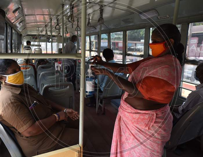 A Women Uses A Sanitiser As She Boards On A Public Bus After The Government Eased A Nationwide Lockdown Imposed As A Preventive Measure Against The Covid-19 Coronavirus, In Chennai On September 1, 2020.