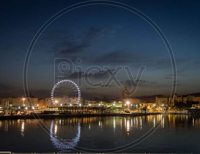 View Of Malaga City  And Giant Wheel From Harbour, Malaga, Spain, Europe At Night