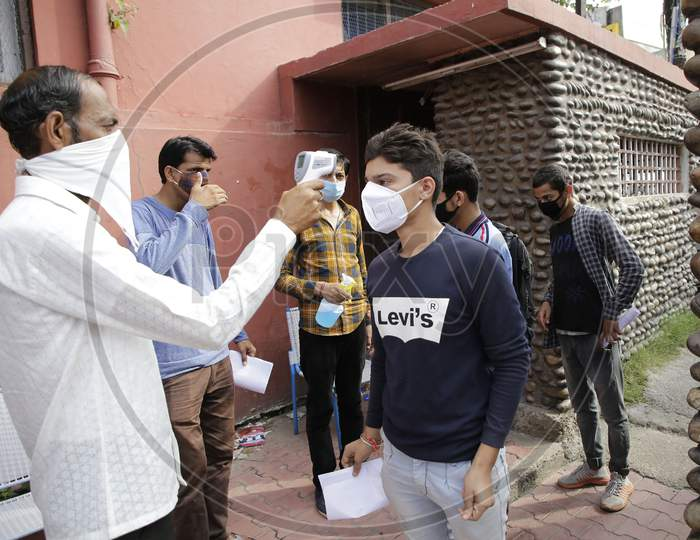 National Defence Academy (NDA) aspirants being screened as per COVID-19 protocol before allowing into an examination centre in Jammu August 6, 2020.