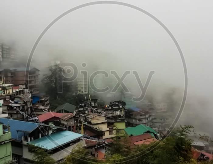 Beautiful Gangtok City Covered By Fog.