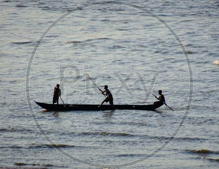 Fisherman fishing on boat in the Mahanadi river at Naraj, Cuttack