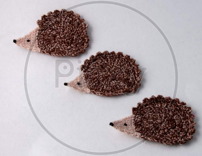 3 Cute Brown Woollen Hedgehog , Handmade Craft Of Crochet, Isolated On White