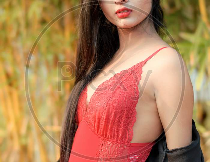 Portrait Of Very Beautiful Young Attractive Woman Wearing Red Outfit With Black Jacket Posing Fashionable In A Blurred Background. Lifestyle & Fashion.