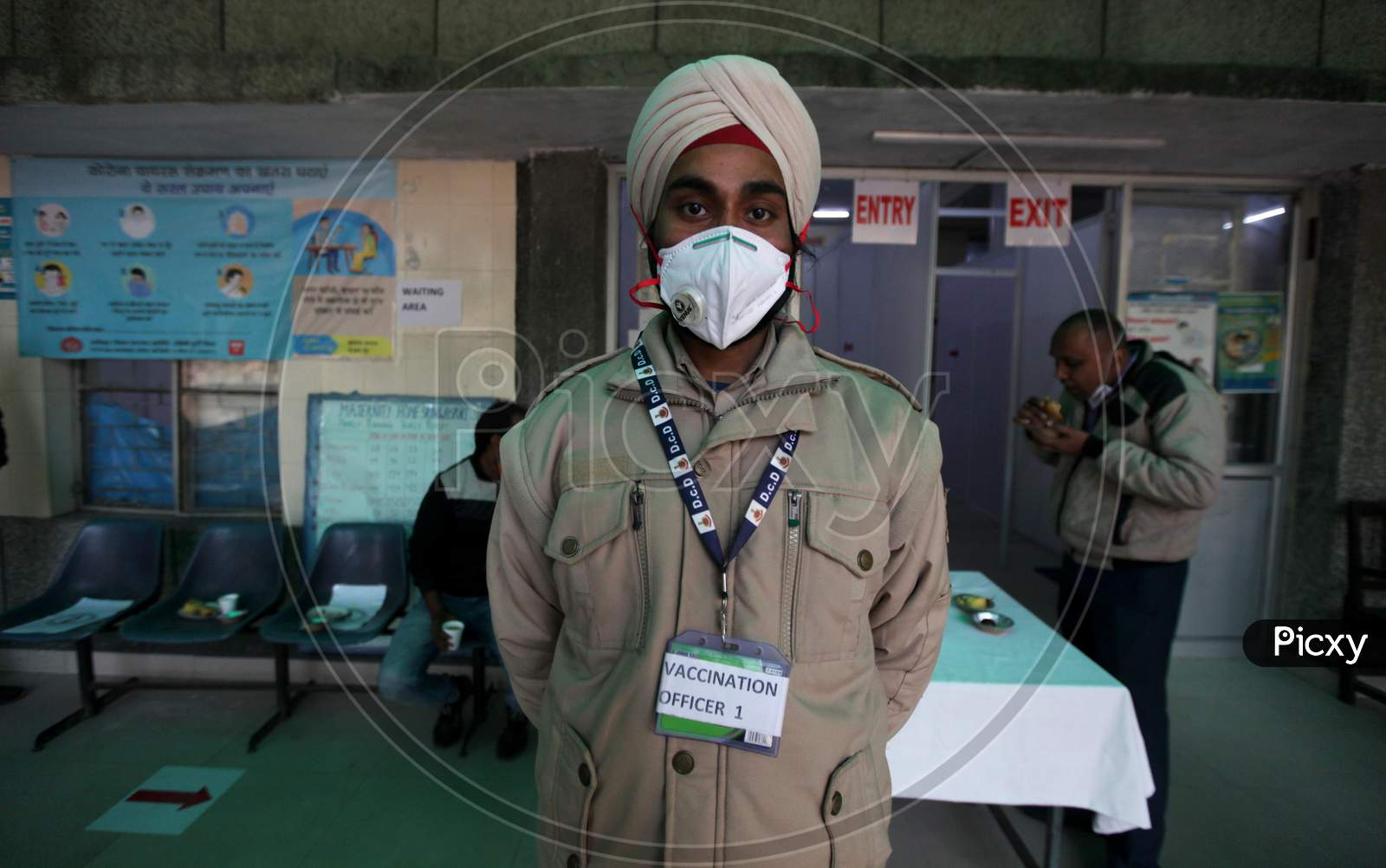 A Worker stands outside a vaccination center set up at a MCD maternity home ahead of a nationwide trial of a Covid-19 vaccine delivery system in New Delhi, India, on, Jan 1, 2021. India will test its Covid-19 vaccine delivery system with a nationwide trial on Jan 2