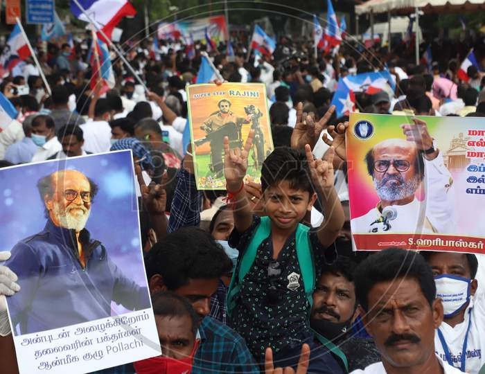 """Fans of superstar Rajinikanth stage a demonstration demanding from him to join politics as earlier as promised, at Valluvar Kottam in Chennai, Sunday, Jan. 10, 2021. The actor, who finally appeared ready to launch his political party with a """"now or never"""" announcement about a month ago, has now deci"""