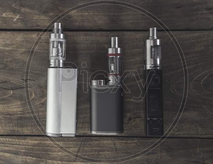 Advanced Vaping Device, E-Cigarette On The Table.