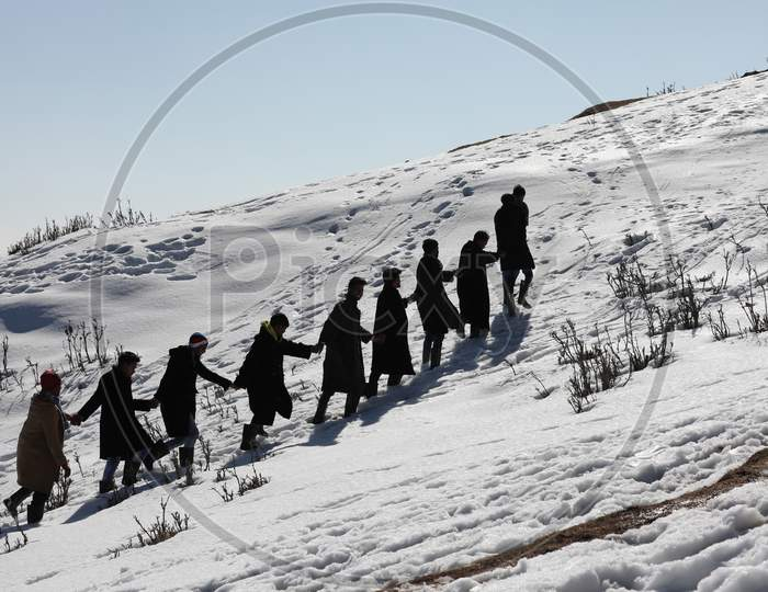 Tourist Walk In Snow Cover Area At Nathatop Near Patnitop About 110Km From Jammu On Sunday.10 Jan,2021.