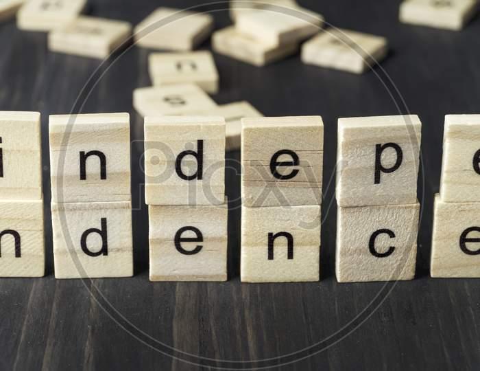 Word  Independence Written On Wooden Blocks