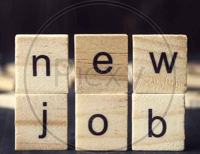 New Job Written On Wooden Alphabet Blocks