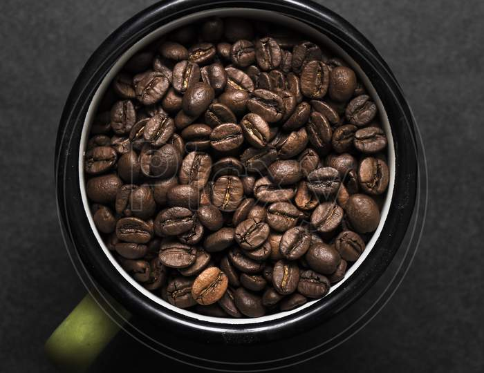 Fresh Roasted Coffee Beans In Metal Coffee Cup