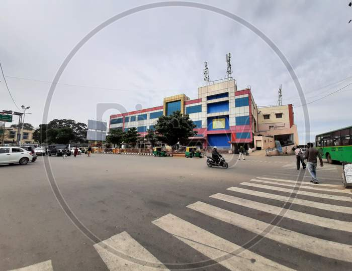 Beautiful view of Banashankari BMTC Bus Stand Building and Metro Station. One Side Vehicles are moving in the Circle.
