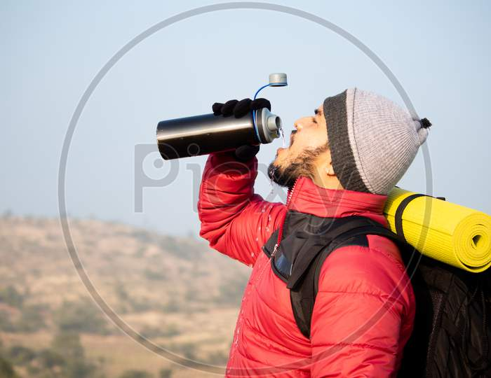Thirsty Travler Drinking Water By Taking Break While Climbing - Concept Of Drink Water Before Feeling Thirsty.